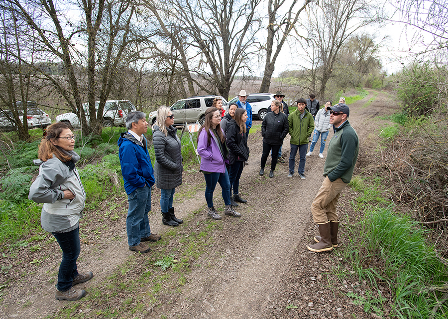 California Water Commissioner Carol Baker, far left, attends a tour of the Oneto-Denier Floodplain Restoration Project in the Cosumnes River Watershed near Galt, led by Field and Lab Director Carson Jeffres, PhD, far right, of the Center for Watershed Sciences, University of California, Davis.