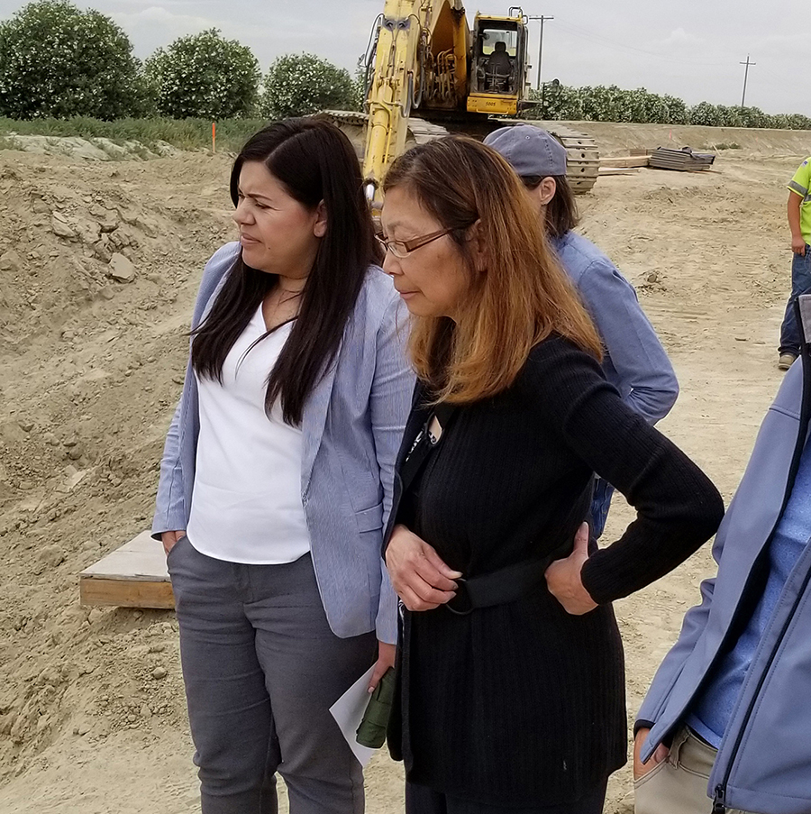 California Water Commissioner Maria Herrera, left, and Commission Vice-Chair Carol Baker, second from left, during a tour of the McMullin On-Farm Flood Capture and Recharge Project.