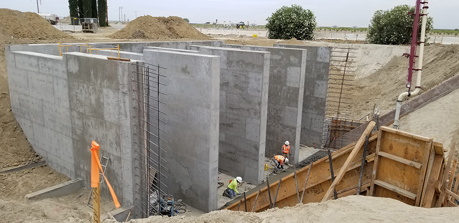 Work progresses on the construction of a pumping station that will house four 450-horsepower pumps capable of pumping a total of 500 cubic feet/second into canals heading north and east.