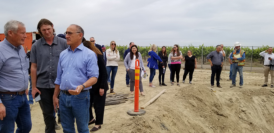 Terranova Ranch manager Don Cameron, left, talks to California Water Commission Chairman Armando Quintero, third from left, during a tour of the McMullin On-Farm Flood Capture and Recharge Project.